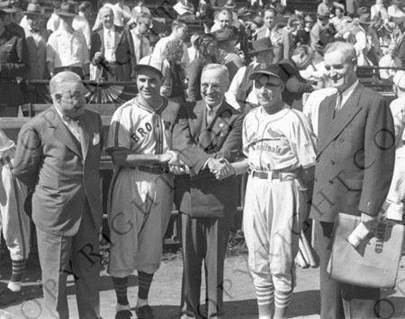 Senator Harry S. Truman shakes hands with the managers of the St. Louis Cardinals and the St. Louis Browns at the 1944 World Series in St. Louis, Missouri.