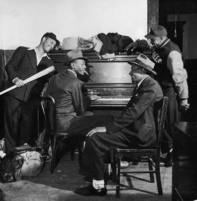 Satchel plays some boogie woogie on the piano for the Black Yankees. His playing shows more gusto than polish and considerably less talent than his baseball playing.