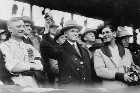 President Coolidge prepares to throw out the first ball of game three of the 1925 World Series, 1925