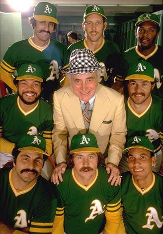 Oakland A's owner Charles O. Finley (center) poses with (clockwise from top L-R) Rollie Fingers, Joe Rudi, Vida Blue, Gene Tenace, Bert Campaneris, Jim Catfish Hunter, Sal Bando & Reggie Jackson during a 1974 SI photo shoot. (Neil Leifer/SI) SI...
