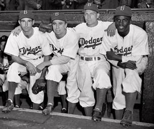 Brooklyn Dodgers baseball players, from left, John Jorgensen, Pee Wee Reese, Ed Stanky and Jackie Robinson pose at Ebbets Field on April 15, 1947, in New York. (AP)