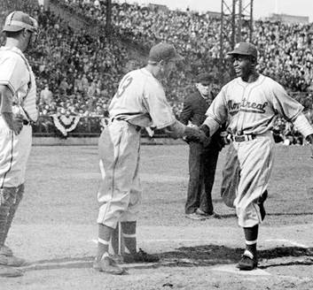 George Shuba greeted Jackie Robinson, right, when Robinson broke baseball's color barrier in a minor league game in 1946.