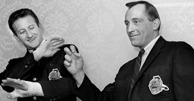 Atlanta Braves pitcher Phil Niekro, right, shows the grip he uses on his famed knuckleball and Bob Uecker, who has to catch it, goes into his protective pose as the visit with fans during the annual BravesÕ caravan at the Hermitage Hotel Feb. 8, 1968.